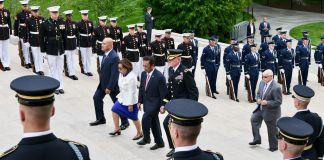 People walking up steps between military cordons (State Dept.)
