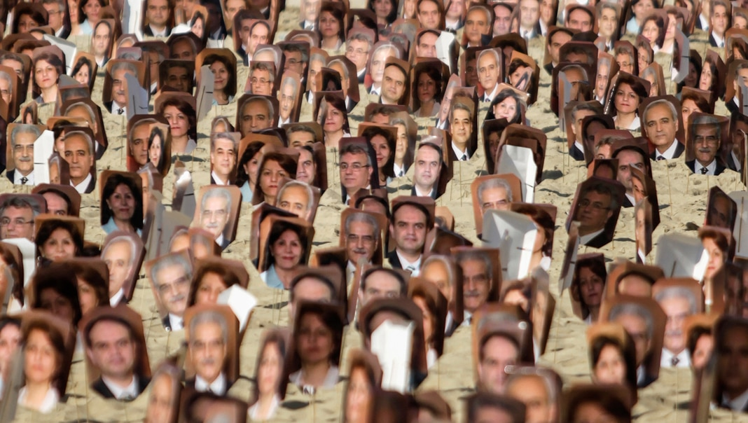 Multiple pictures of Baha'i religious leaders (© Ricardo Moraes/Reuters)