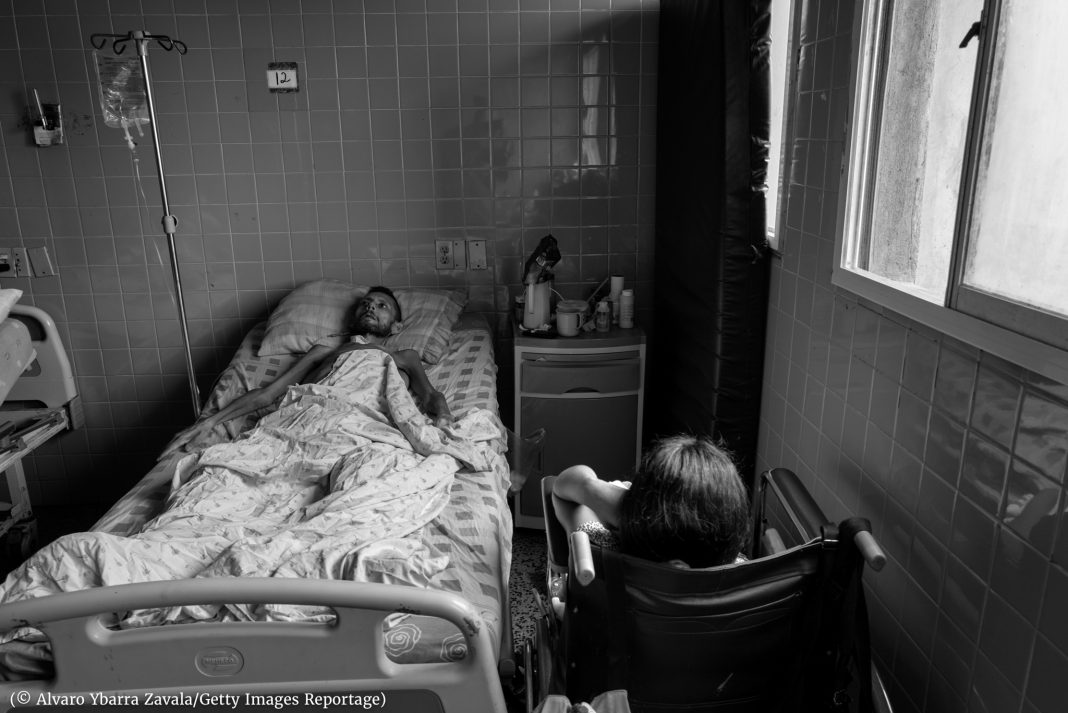 Ill person lying on bed (Alvaro Ybarra Zavala/Getty Images Reportage)