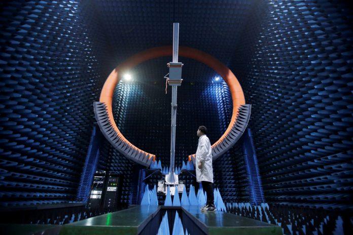 Man standing inside antenna testing room (© Jason Lee/Reuters)