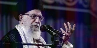Supreme Leader of Iran Ali Khamenei at microphone