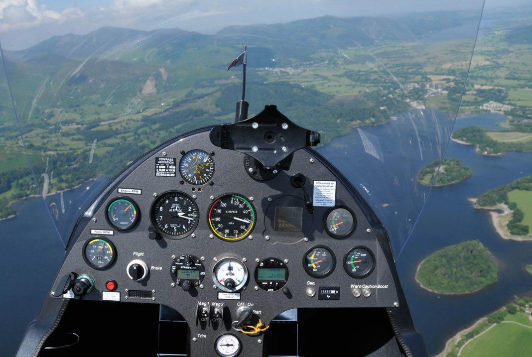 Cockpit of autogyro plane above lake (© Andrew Macdonald/Alamy)