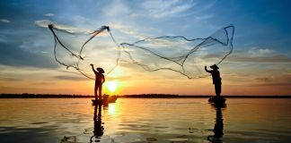 Fishers throwing nets from small boats (© CW Pix/Shutterstock)