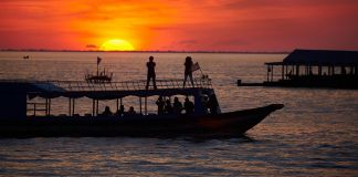 Sunset over boats (© David Wall/Alamy)