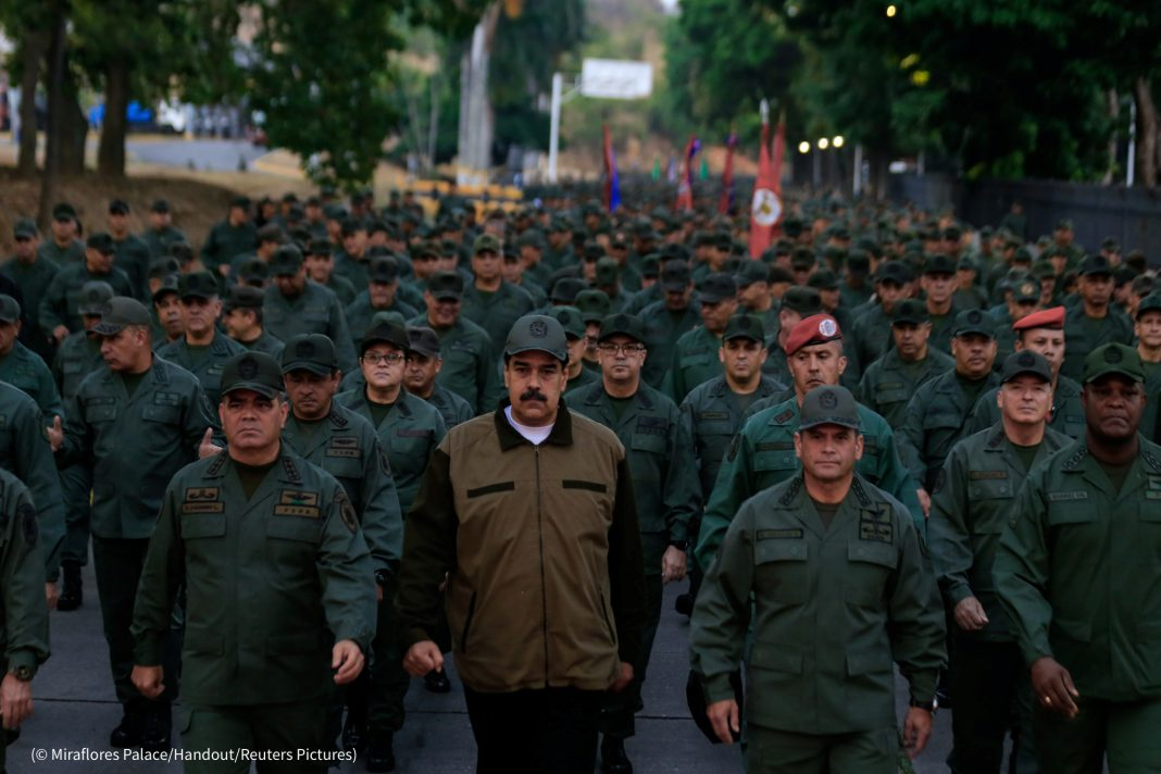 Nicolás Maduro walking with a large group of uniformed men (© Miraflores Palace/Handout/Reuters Pictures)