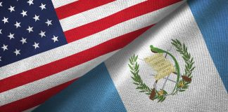 Canvas U.S. flag ontop of canvas Guatemala flag (© Shutterstock)
