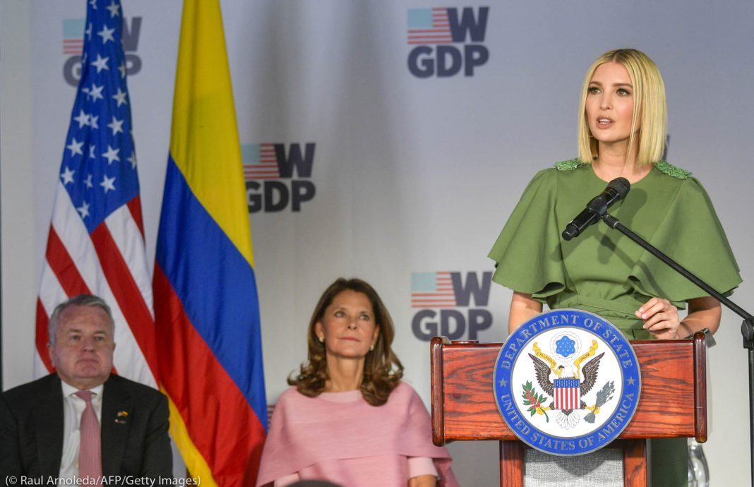 Ivanka Trump speaking at lectern as John Sullivan and Marta Lucía Ramírez look on (© Raul Arboleda/AFP/Getty Images)