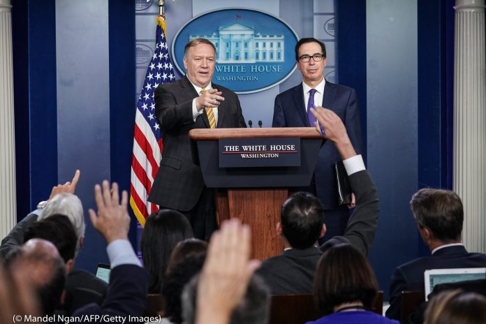Pompeo and Mnuchin at lectern taking questions from reporters (© Mandel Ngan/AFP/Getty Images)