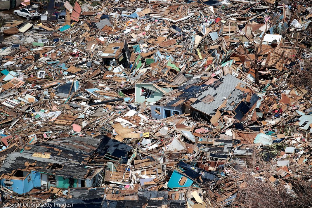 Aerial view of flattened buildings and debris (© Scott Olson/Getty Images)