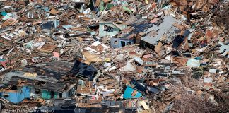 Aerial view of flattened buildings and debris (©Scott Olson/Getty Images)