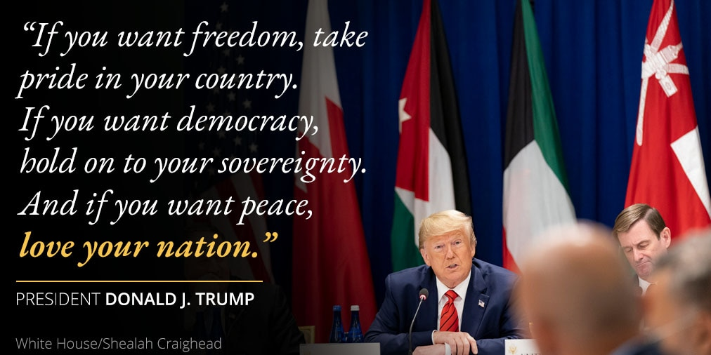 President Trump's remarks on loving your nation; photo of Trump sitting in front of flags (White House/Shealah Craighead)