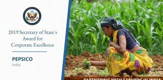 Photo of woman crouching in field; PepsiCo's citation for State Department's Award for Corporate Excellence (© Ashima Narain/Pepsico)