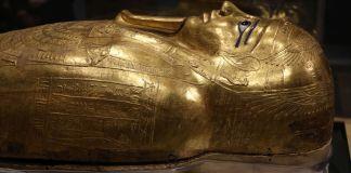 Head of a golden coffin holding a mummy (© Mahmoud Bakkar/AP Images)