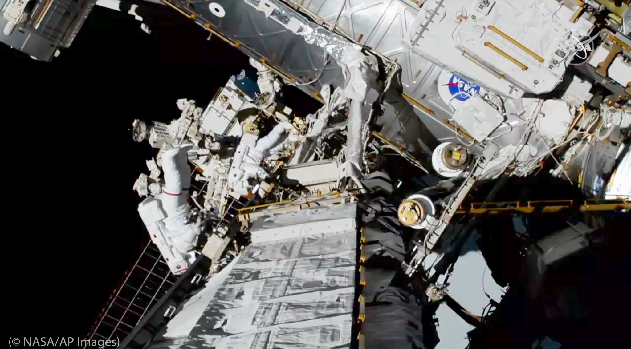 Astronauts exiting International Space Station (©NASA/AP Images)