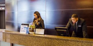 People behind customer-service counter (© Education & Exploration 1/Alamy Stock Photo)