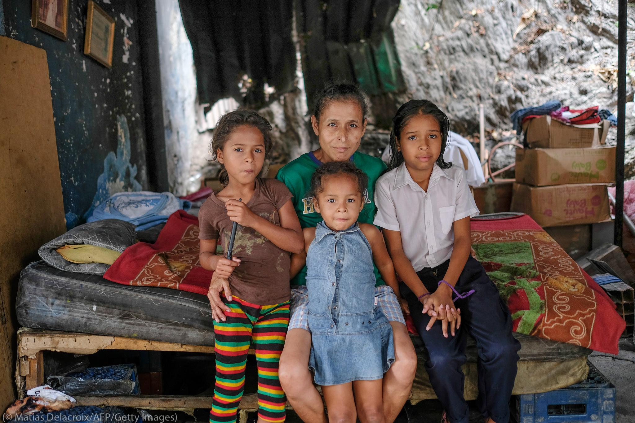 Venezuelan family posing for portrait (© Matias Delacroix/AFP/Getty Images)