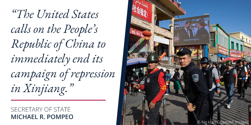 Photo of uniformed men on a Chinese street next to Pompeo quote on repression in Xinjiang (State Dept./S. Gemeny Wilkinson/Photo © Ng Han Guan/AP Images)