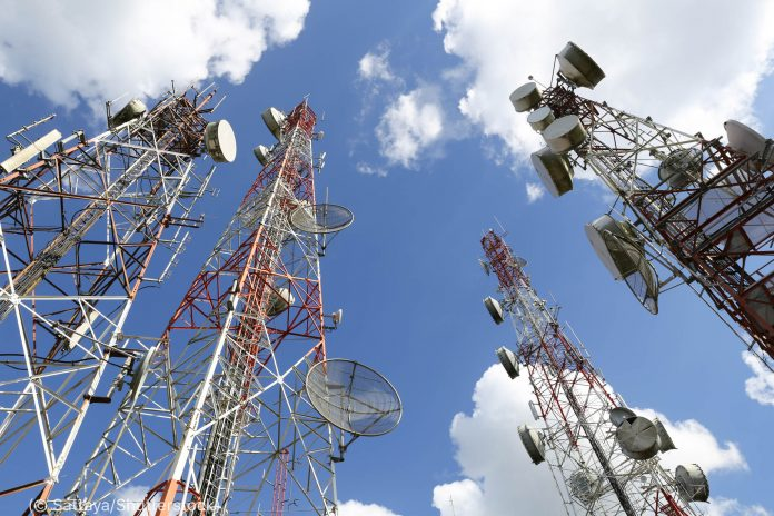 Telecommunication tower with blue sky and cloud (© Sattaya/Shutterstock)