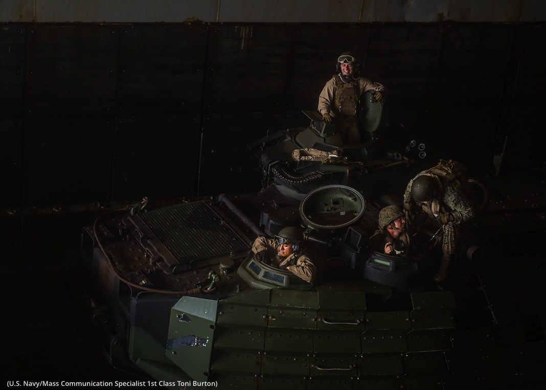 Service members getting into amphibious vehicles (U.S. Navy/Mass Communication Specialist 1st Class Toni Burton)