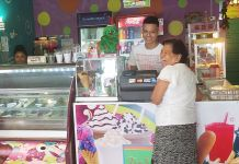 Hernan Urbina and woman standing by cash register (Courtesy of Ice Break)