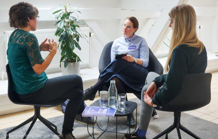 Mentor Puk Falkenberg, of Bloch&Østergaard ApS, center, works with attendees during a mentoring session at Women's Entrepreneurship Roadshow