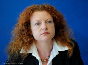 Photo of woman's head (© Christof Stache, AP Images)