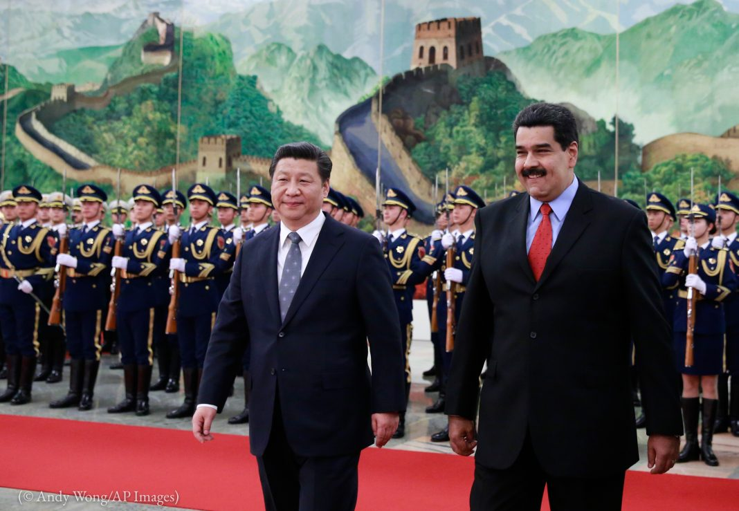 Venezuela's President Nicolas Maduro, right, walks with Chinese President Xi Jinping during a welcome ceremony at the Great Hall of the People in Beijing, China