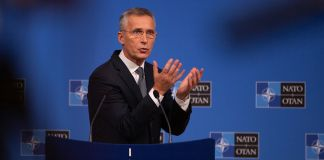 Jens Stoltenberg at lectern (© Virginia Mayo/AP Images)
