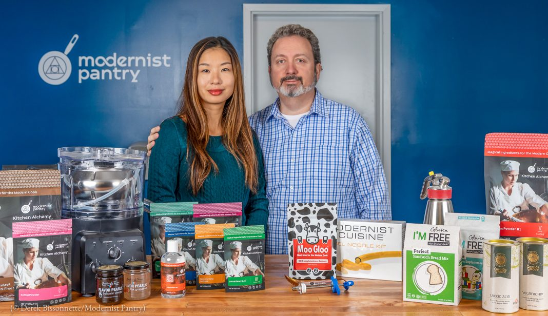 Company owners posing in front of some of the Modernist Pantry products (© Derek Bissonnette/Modernist Pantry)