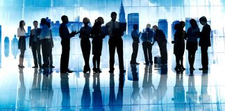 Silhouette of business people standing and working (© Shutterstock)