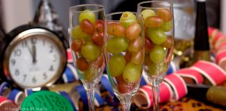 Three champagne glasses filled with grapes (© AP Images)