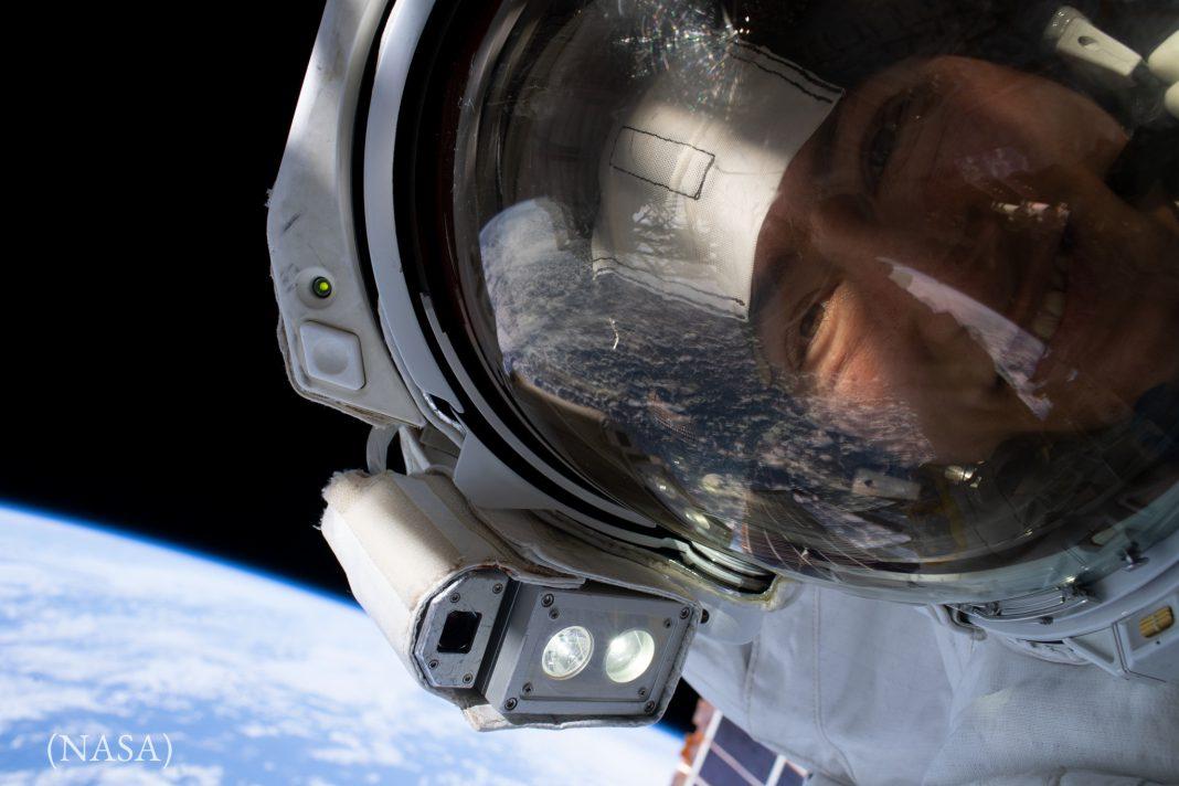 Head of person wearing helmet in space (NASA)