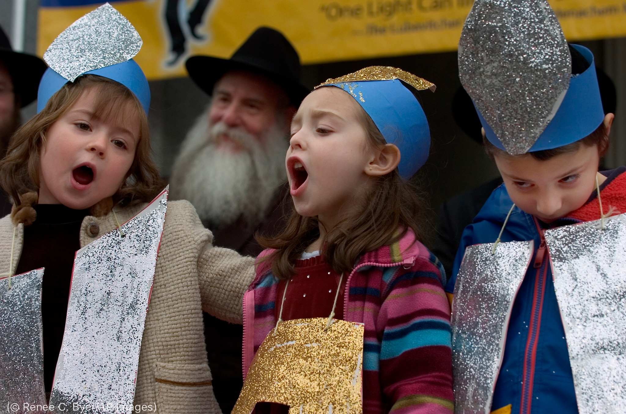 Children singing and wearing hats (© Renee C. Byer/AP Images)