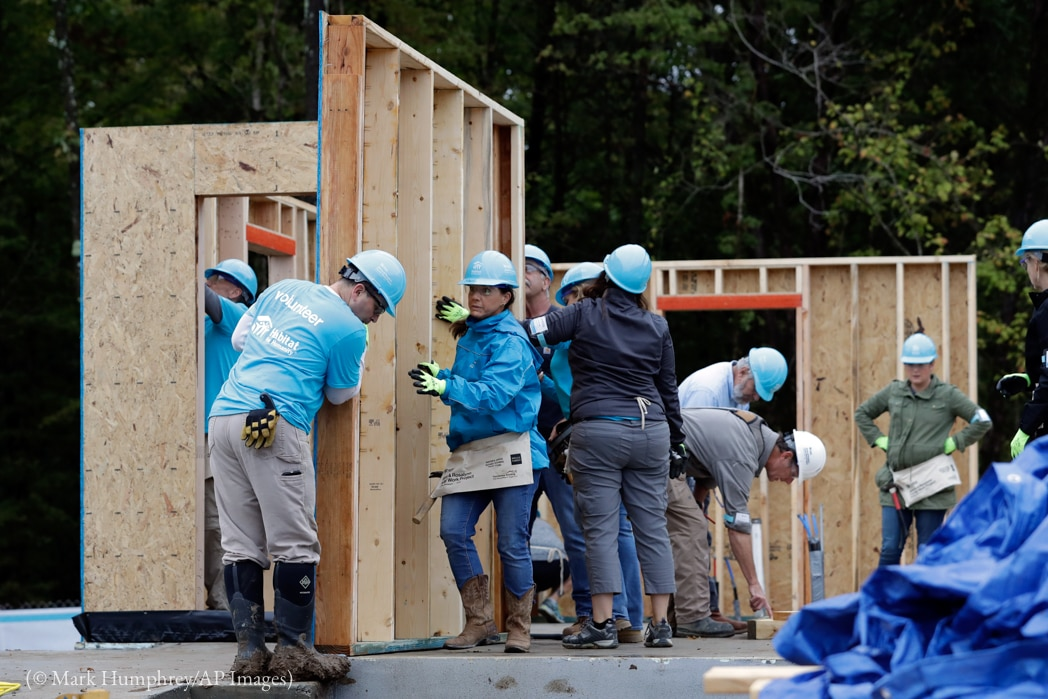 Volunteers working at a Habitat for Humanity building project (© Mark Humphrey/AP Images)