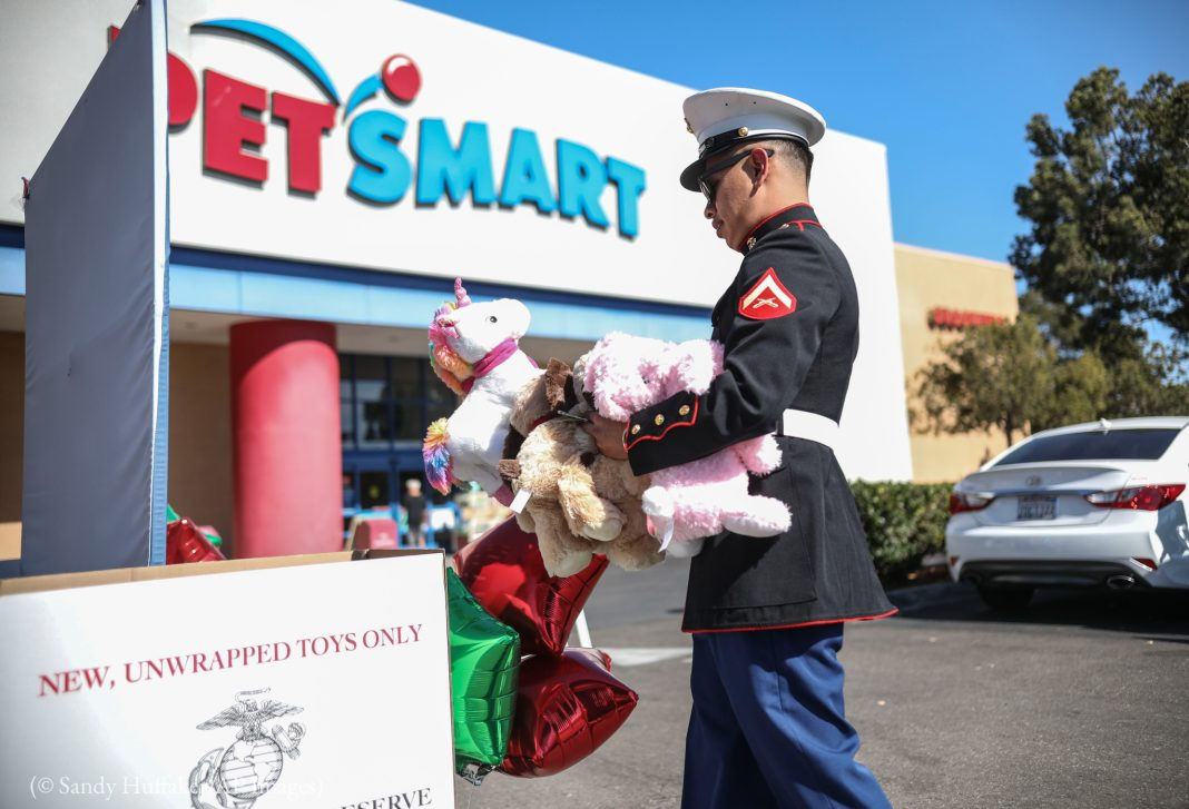 An U.S. Marine dropping off toys at a Toys for Tots drive