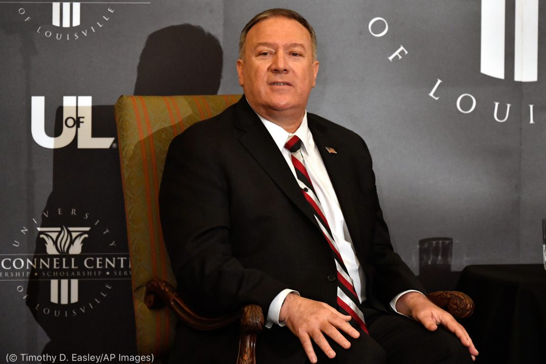 Mike Pompeo sitting (© Timothy D. Easley/AP Images)