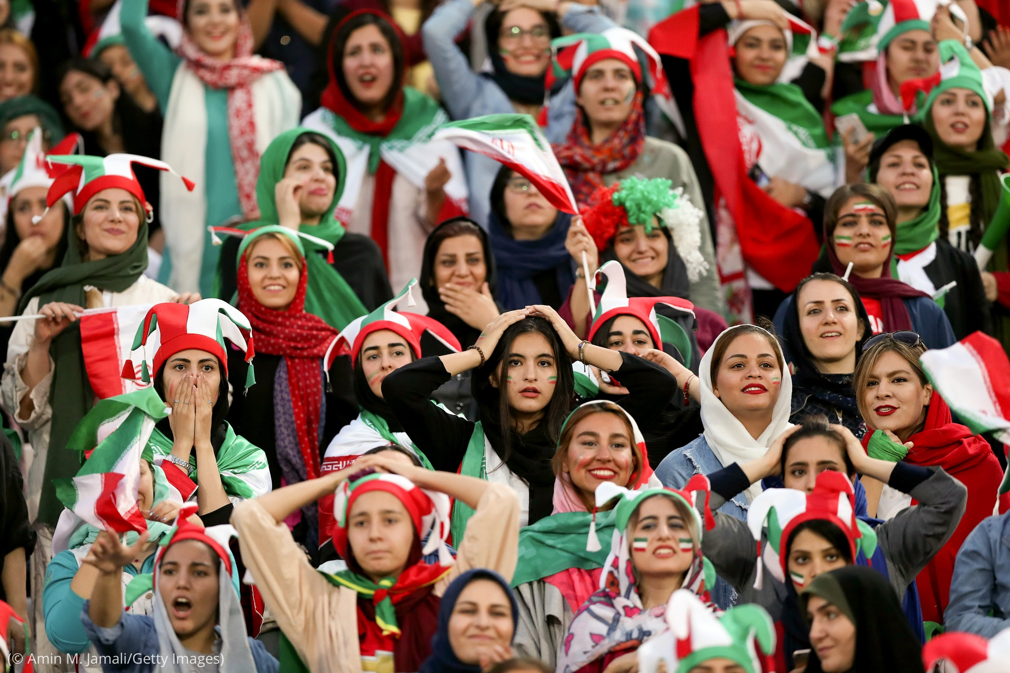 Women in crowd reacting (© Amin M. Jamali/Getty Images)