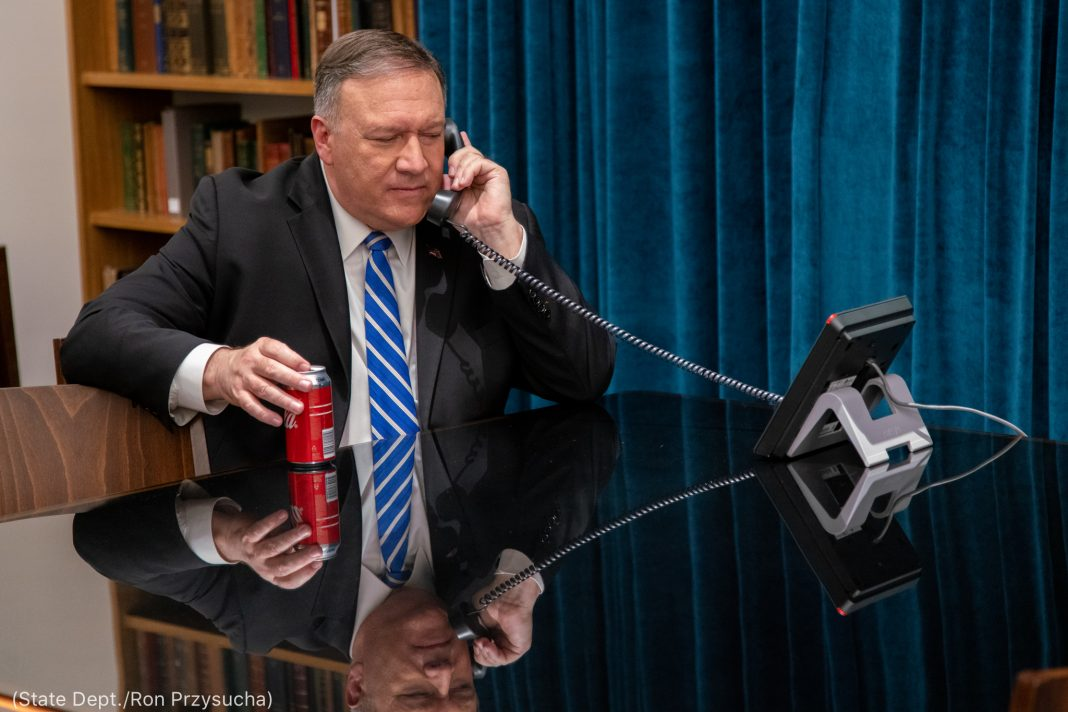 Mike Pompeo speaking on phone (State Dept./Ron Przysucha)