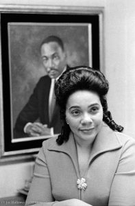 Woman sitting in front of portrait (© Joe Holloway Jr./AP Images)