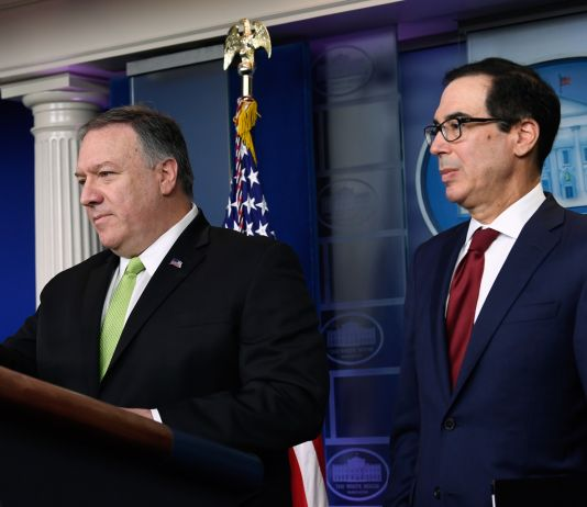 Secretary of State Mike Pompeo and Treasury Secretary Steven Mnuchin standing at lectern (© Susan Walsh/AP Images)