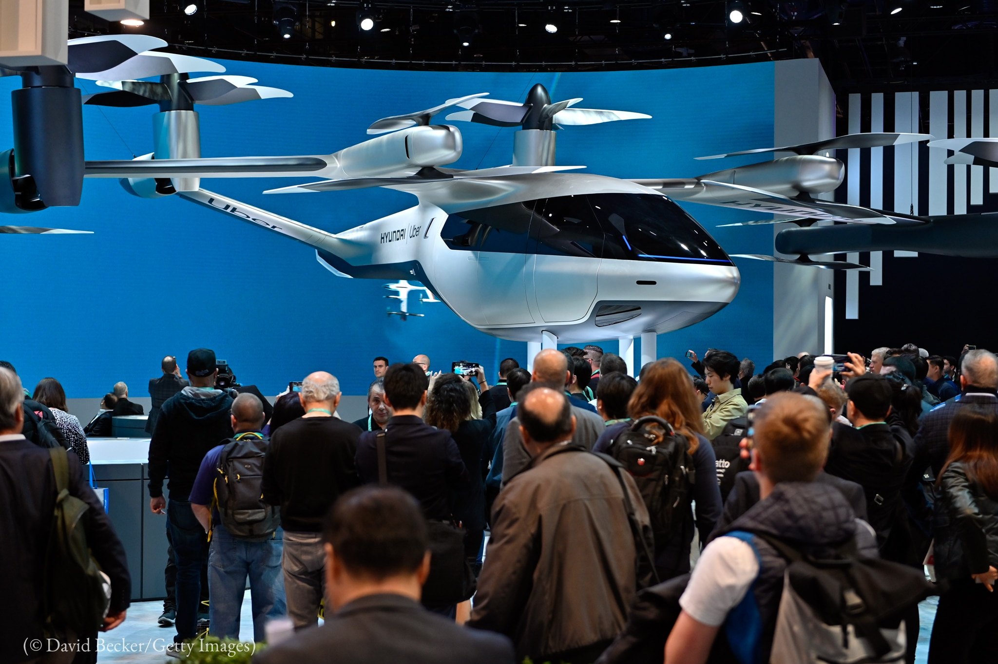 Helicopter on display before crowd (© David Becker/Getty Images)