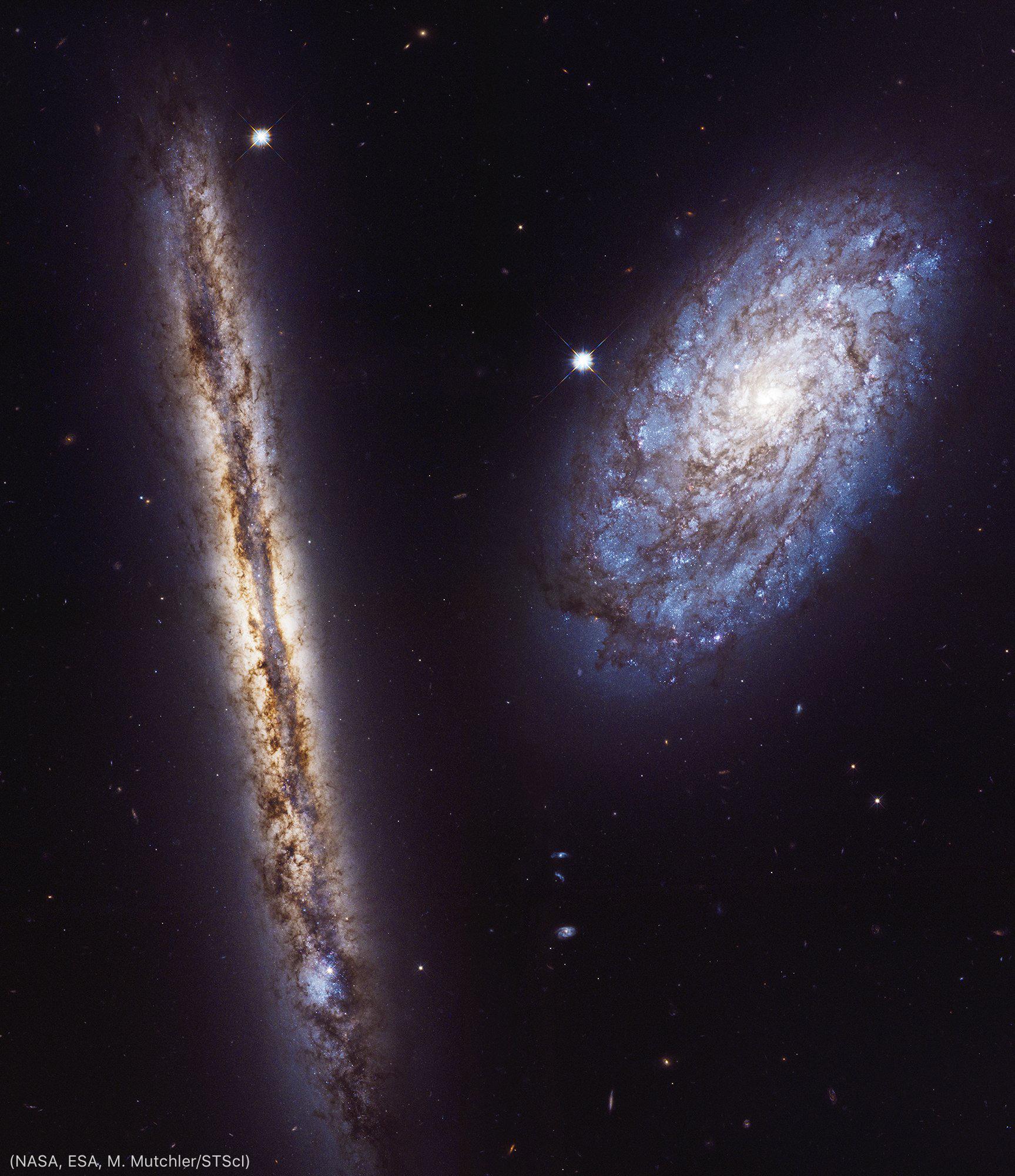 Two galaxies (NASA, ESA, M. Mutchler/STScI)