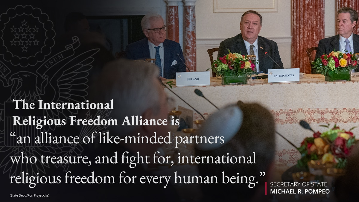 Photo of Secretary Pompeo at table with others, with overlaid quote on the International Religious Freedom Alliance (State Dept./Ron Przysucha)