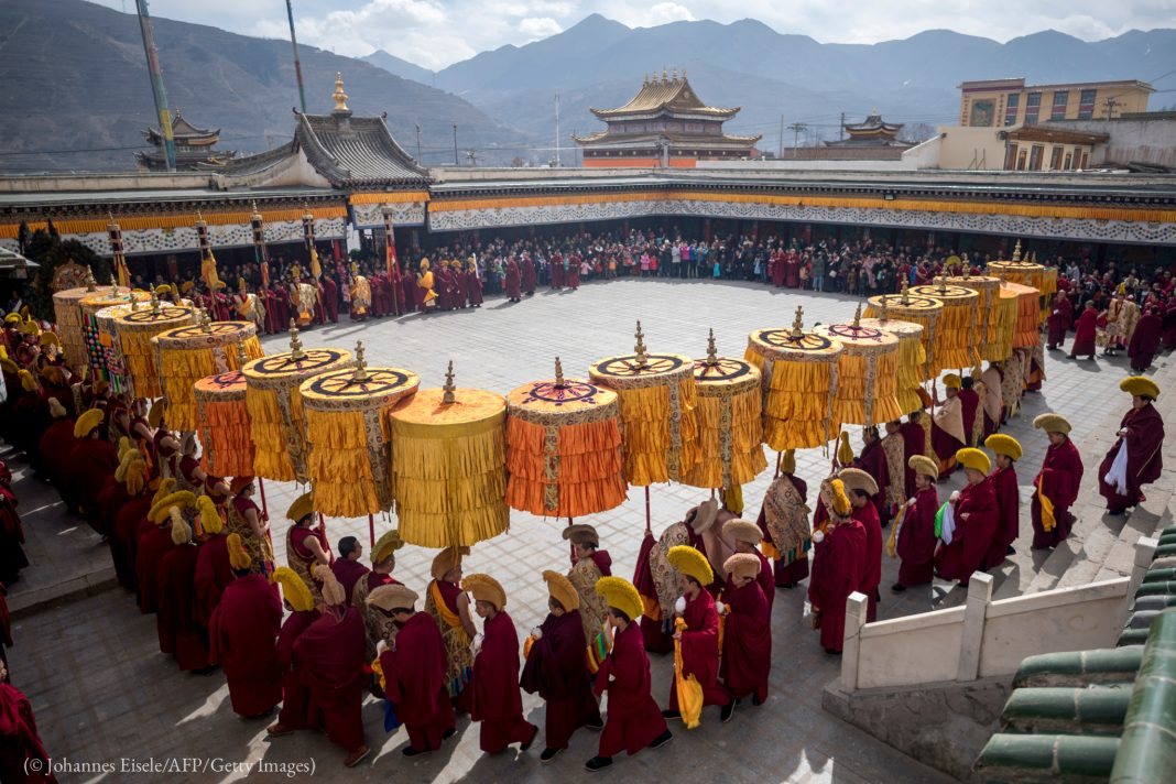 Tibetan Buddhist monks praying during a Losar ceremony