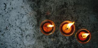 Overhead view of three burning candles (© Shutterstock)