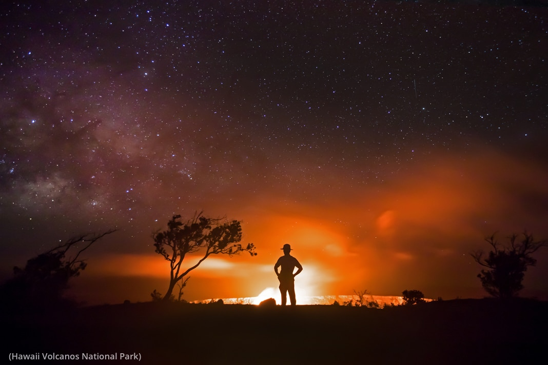 Person in silhouette against glowing volcano (Hawai'i Volcanos National Park)