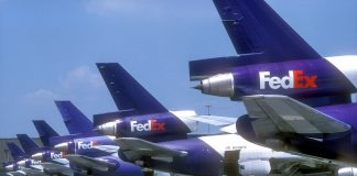 FedEx airplanes on a tarmac (© Greg Campbell/AP Images)