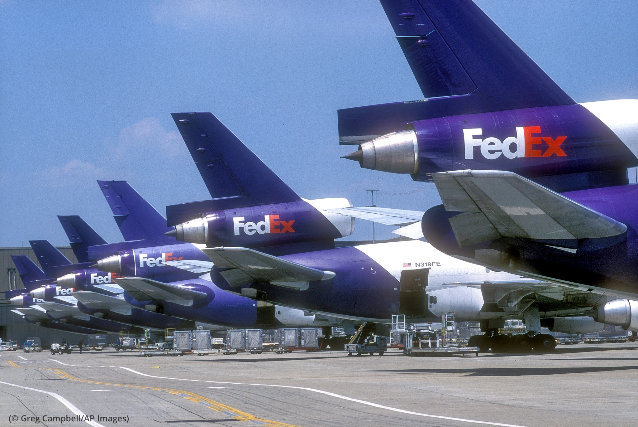 Row of aircraft with 'Fedex' painted on tail (© Greg Campbell/AP Images)
