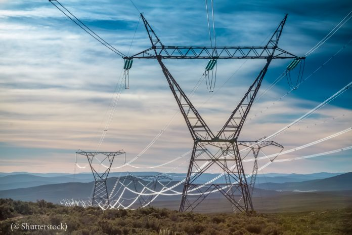 Electricity pylons with the early morning light gleaming off the cables in South Africa (© Shutterstock)