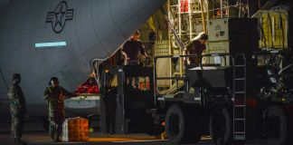 Airmen loading medical supplies at night onto an aircraft (U.S. Air Force/Technical Sergeant Rebeccah Woodrow)